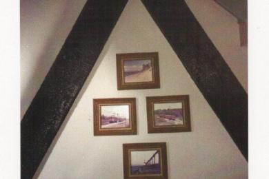 church interior wall with photos